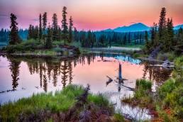 sun sets over a lake in Wrangell-St Elias National Park, Alaska